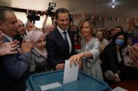 Asma, wife of Syria's President Bashar al-Assad, casts her vote during the country's presidential elections in Douma