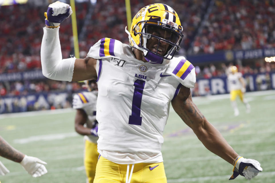 FILE - In this Dec. 7, 2019, file photo, LSU wide receiver Ja'Marr Chase (1) celebrates his touchdown against Georgia during the first half of the Southeastern Conference championship NCAA college football game, in Atlanta. Ja'Marr Chase was one of three players from LSU's high-powered offense to earn unanimous first-team all-SEC honors when The Associated Press All-Southeastern Conference football team was announced Monday, Dec. 9, 2019. (AP Photo/John Bazemore, File)