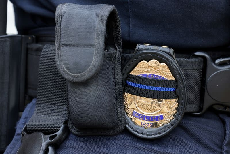 FILE PHOTO: A U.S. Capitol police officer's badge shows a black stripe in honor of deceased colleagues in Washington