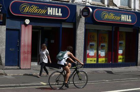 A cyclist passes a William Hill betting shop in London
