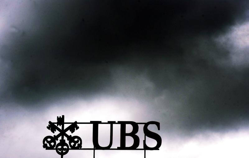 FILE - The July 14, 2011 file photo shows dark clouds above the UBS logo on the bank's head office in Zurich, Switzerland.  UBS AG agreed Wednesday, Dec. 19, 2012 to pay some US$ 1.5 billion in fines to international regulators following a probe into the rigging of a key global interest rate. In admitting to fraud, Switzerland's largest bank became the second bank, after Britain's Barclays PLC, to settle over the rate-rigging scandal. The fine, which will be paid to authorities in the U.S., Britain and Switzerland, also comes just over a week after HSBC PLC agreed to pay nearly US$ 2 billion for alleged money laundering.  (AP Photo/Keystone, Walter Bieri)