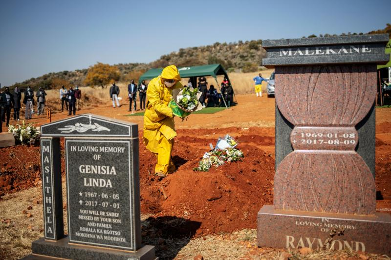 There. are fears South Africa's coronavirus death toll is much higher, after a spike in deaths deemed as 'natural causes'. Source: AFP
