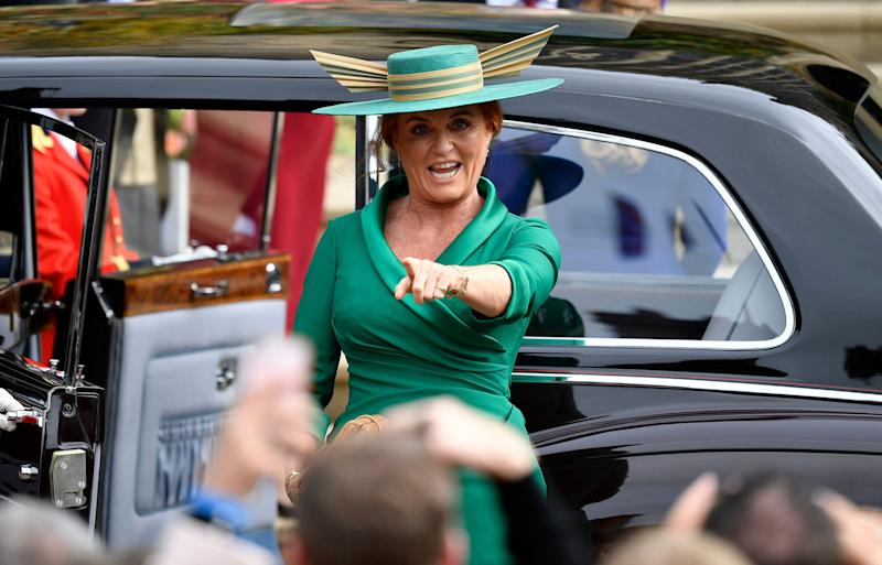 Sarah Ferguson making a face as she exits the car to head to St. George's Chapel.
