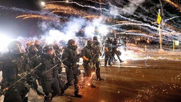 PHOTO: FILE - In this Sept. 5, 2020, file photo, police use chemical irritants and crowd control munitions to disperse protesters during a demonstration in Portland, Ore.  (Noah Berger/AP)