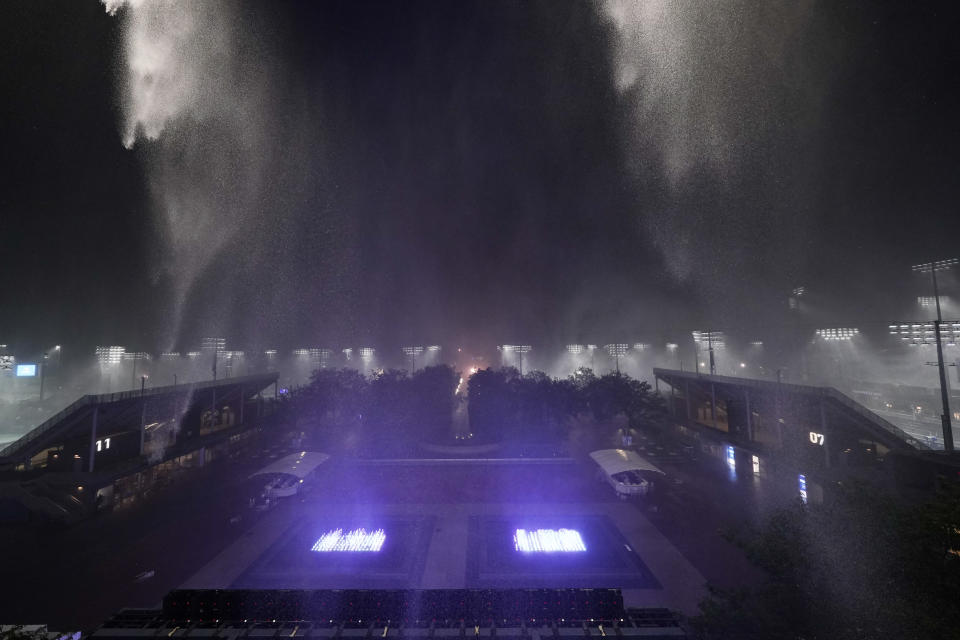 Rain falls outside Arthur Ashe Stadium during the second round of the US Open tennis championships, Wednesday, Sept. 1, 2021, in New York. (AP Photo/Frank Franklin II)