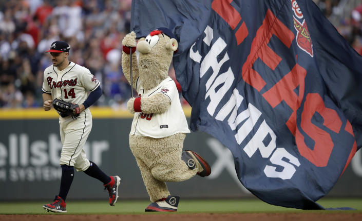 Atlanta Brave mascot 'Blooper' follows Braves' Adam Duvall (14) off the field at the end of a baseball game against the New York Mets Sunday, Oct. 3, 2021, in Atlanta. (AP Photo/Ben Margot)