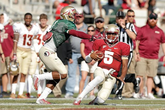 TALLAHASSEE, FL - APRIL 12: Jameis Winston #5 of the Garnet team slides in front of Tyler Hunter #1 of the Gold team during Florida State's Garnet and Gold spring game at Doak Campbell Stadium on April 12, 2014 in Tallahassee, Florida. (Photo by Stacy Revere/Getty Images)