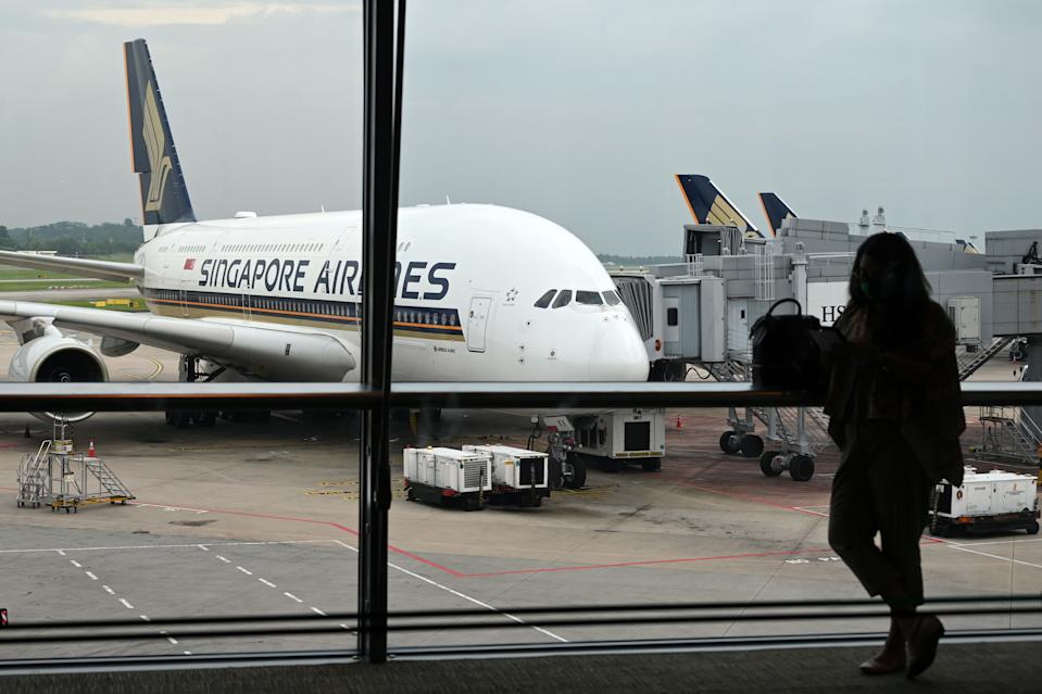 A Singapore Airlines Airbus A380 plane is seen parked on the tarmac at Changi International Airport in Singapore on October 24, 2020. (Photo by ROSLAN RAHMAN / AFP) (Photo by ROSLAN RAHMAN/AFP via Getty Images)