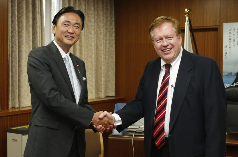 Bob King, the U.S. special envoy for North Korean human rights issues, right, shakes hands with Japanese National Public Safety Commission Chairman Keiji Furuya during their meeting in Tokyo Wednesday, Aug. 29, 2013. King, who will travel to North Korea later this week, said Wednesday that he plans to strongly appeal for the release of an American sentenced to 15 years of hard labor by the authoritarian state but added that Washington has received no guarantees from Pyongyang the ailing man will be freed. (AP Photo/Shuji Kajiyama)