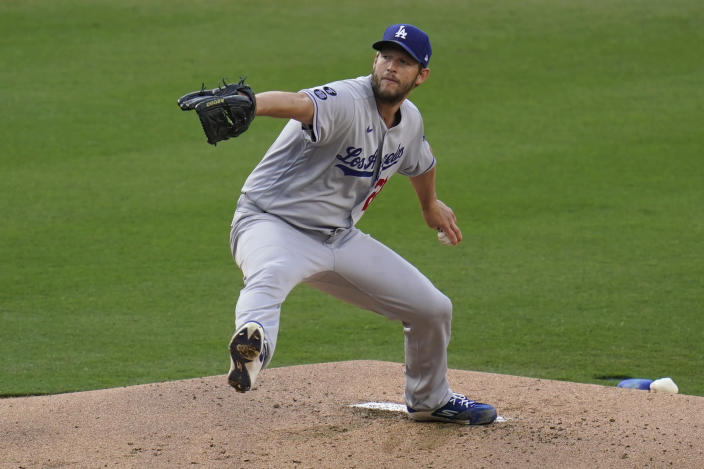 Los Angeles Dodgers starting pitcher Clayton Kershaw works against a San Diego Padres batter during the first inning of a baseball game Saturday, April 17, 2021, in San Diego. (AP Photo/Gregory Bull)