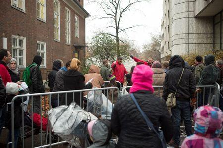 Migrants queue outside LAGESO waiting to register in Berlin