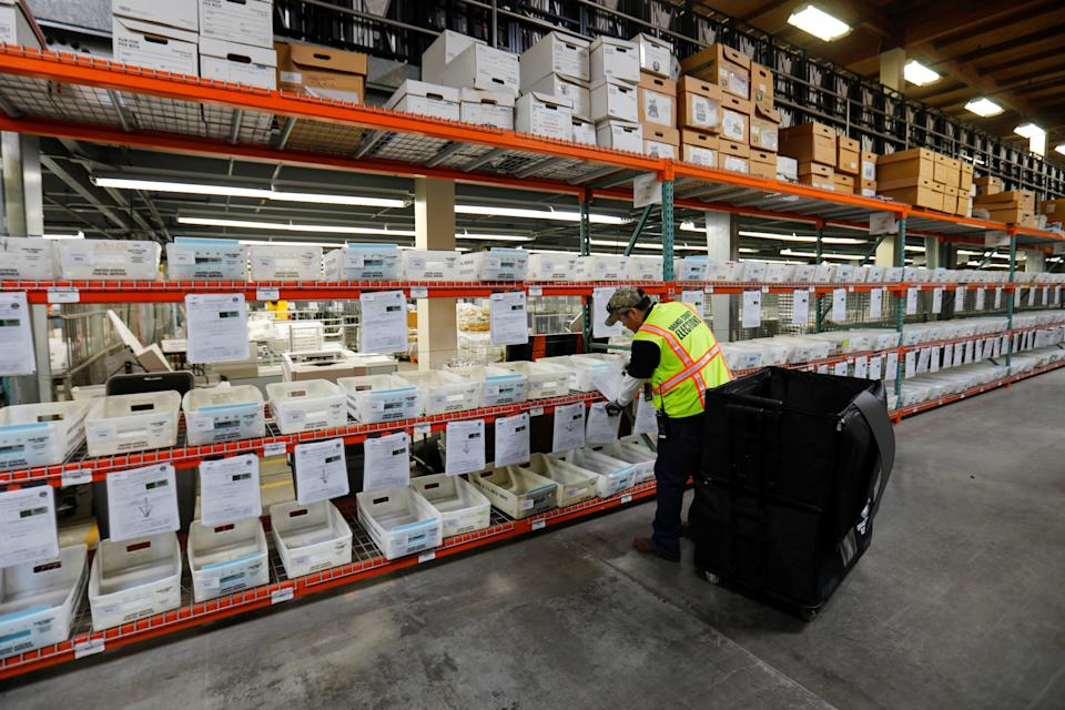 A worker sorts mail in ballots for the March 3 Super Tuesday election at the Orange County Registrar of Voters facilities in  Santa Ana, California, U.S., February 24, 2020. (Mike Blake/Reuters)