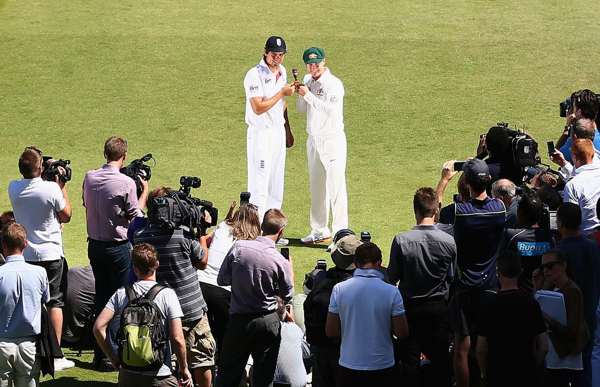 NOTTINGHAM, ENGLAND - JULY 09:  Michael Clarke, Captain of Australia and Alastair Cook, Captain of England, pose with the Ashes Series Trophy at Trent Bridge on July 9, 2013 in Nottingham, England.  (Photo by Ryan Pierse/Getty Images)