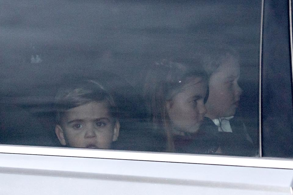 Prince Louis, Princess Charlotte and Prince George leave Buckingham Palace with their parents. (Image via Dominic Lipinski/PA Wire)