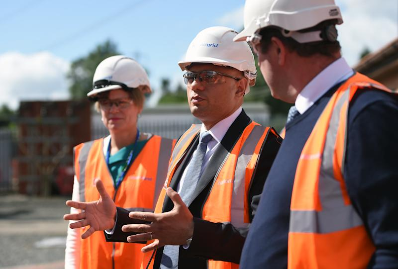Chancellor Sajid Javid (centre) during a visit to the National Grid Training Centre near Newark, as the UK's economy shrank for the first time since 2012 in the second quarter of this year, as the manufacturing and construction sectors both slumped.