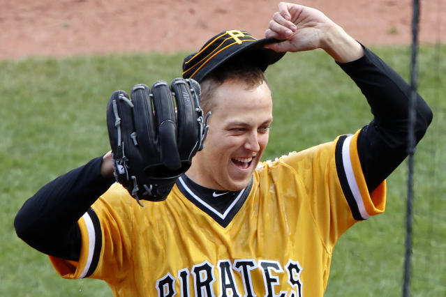 FILE - In this April 8, 2018, file photo, Pittsburgh Pirates starting pitcher Jameson Taillon reacts after being doused by teammate Gregory Polanco as he waits to be interviewed after throwing a complete baseball game, a one-hit shutout against the Cincinnati Reds, in Pittsburgh. The Pirates believe their young core of starting pitching, fronted by Taillon and Tevor Williams, that seemed to get better as 2018 wore on, are ready for another massive step forward in 2019. (AP Photo/Gene J. Puskar/File)