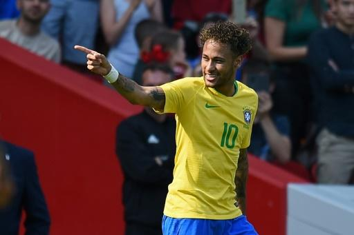Brazil striker Neymar celebrates after scoring against Croatia