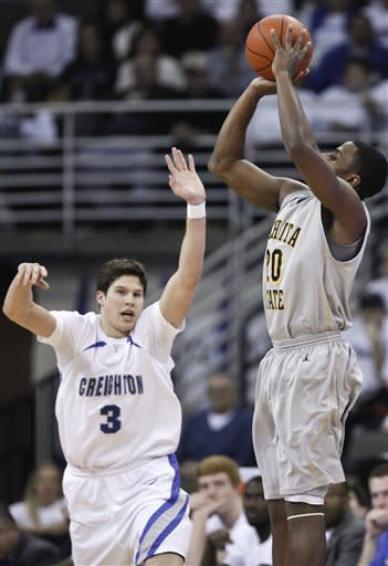 Wichita State's Ben Smith, right, shoots over Creighton's Doug McDermott (3) in the first half of their NCAA college basketball game in Omaha, Neb., Saturday, Feb. 11, 2012. (AP Photo/Nati Harnik)