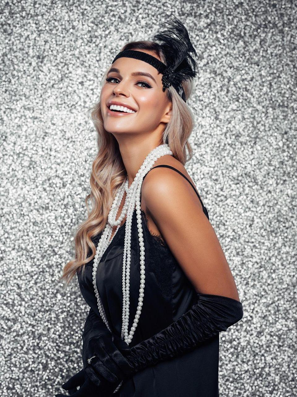 """<p>What better way is there to celebrate the '20s decade than to throw it back to the <em>first</em> Roaring Twenties? Get the countdown to the new decade started by donning your most glamorous flapper costumes, turning up the jazz, and of course breaking out all your <a href=""""https://www.goodhousekeeping.com/food-recipes/party-ideas/g643/great-gatsby-party/"""" rel=""""nofollow noopener"""" target=""""_blank"""" data-ylk=""""slk:Gatsby-inspired party"""" class=""""link rapid-noclick-resp"""">Gatsby-inspired party</a> decorations, like these <a href=""""https://www.amazon.com/Roaring-Twenties-Supplies-Gatsby-Vintage/dp/B07RSJFXJF/ref=sr_1_18_sspa?keywords=gatsby+themed+party&qid=1575390513&sr=8-18-spons&psc=1&spLa=ZW5jcnlwdGVkUXVhbGlmaWVyPUEzM0oyTUlMWURFQ0pKJmVuY3J5cHRlZElkPUEwODIxOTQyVVE4REVCN1gxVlc3JmVuY3J5cHRlZEFkSWQ9QTAzNzE2NDhNQ0oyRk9OV1A4OUsmd2lkZ2V0TmFtZT1zcF9tdGYmYWN0aW9uPWNsaWNrUmVkaXJlY3QmZG9Ob3RMb2dDbGljaz10cnVl&tag=syn-yahoo-20&ascsubtag=%5Bartid%7C10055.g.30105731%5Bsrc%7Cyahoo-us"""" rel=""""nofollow noopener"""" target=""""_blank"""" data-ylk=""""slk:1920's themed photo booth props"""" class=""""link rapid-noclick-resp"""">1920's themed photo booth props</a>.</p>"""