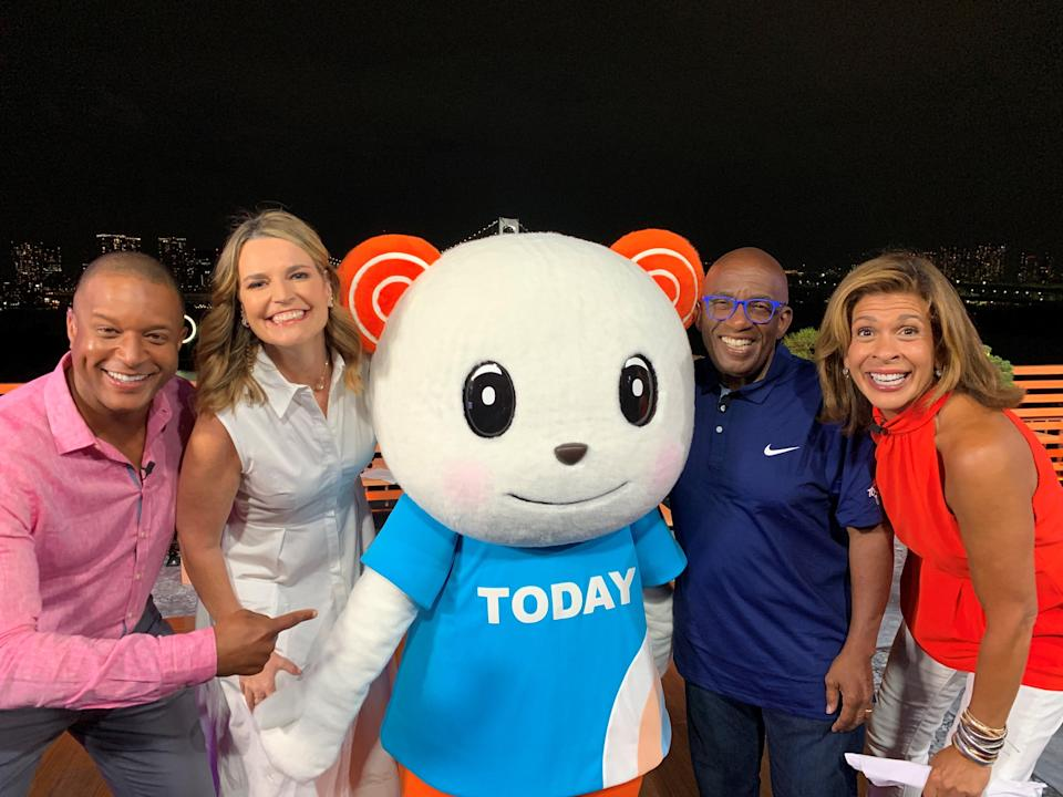 """The anchors surround their """"Today"""" show mascot, which was designed specifically for NBC's morning program."""