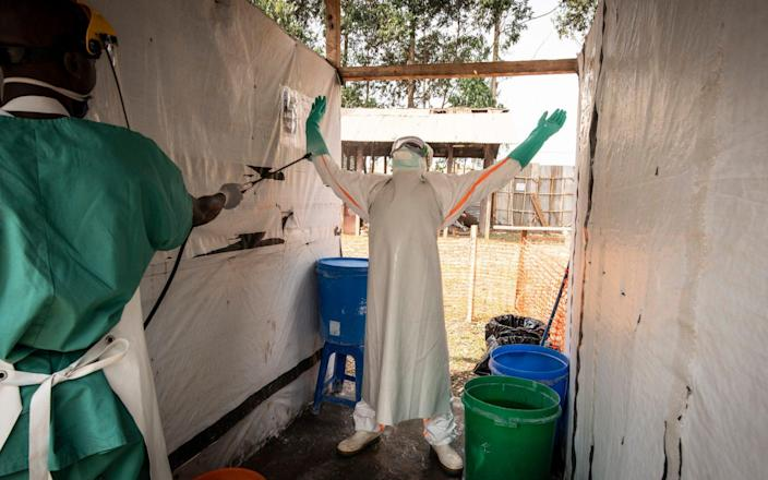 A health worker leaves a treatment centre in Butembo, DRC, earlier this year - Simon Townsley