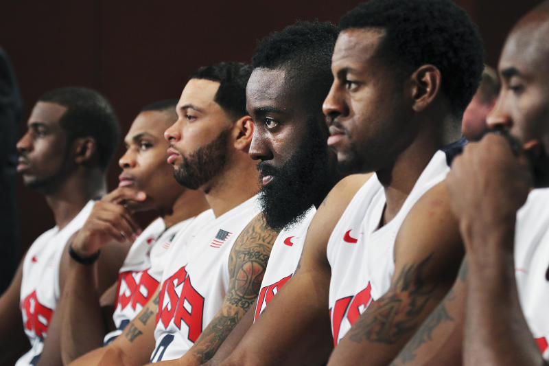 Team member James Harden, third from right, is seen during the USA Olympic Men's basketball team news conference announcing the final roster for London in Las Vegas on Saturday, July 7, 2012. From left is Chris Paul, Russell Westbrook, Deron Williams, Harden, Andre Iguodala and Kobe Bryant. (AP Photo/Las Vegas Review-Journal, Jason Bean)