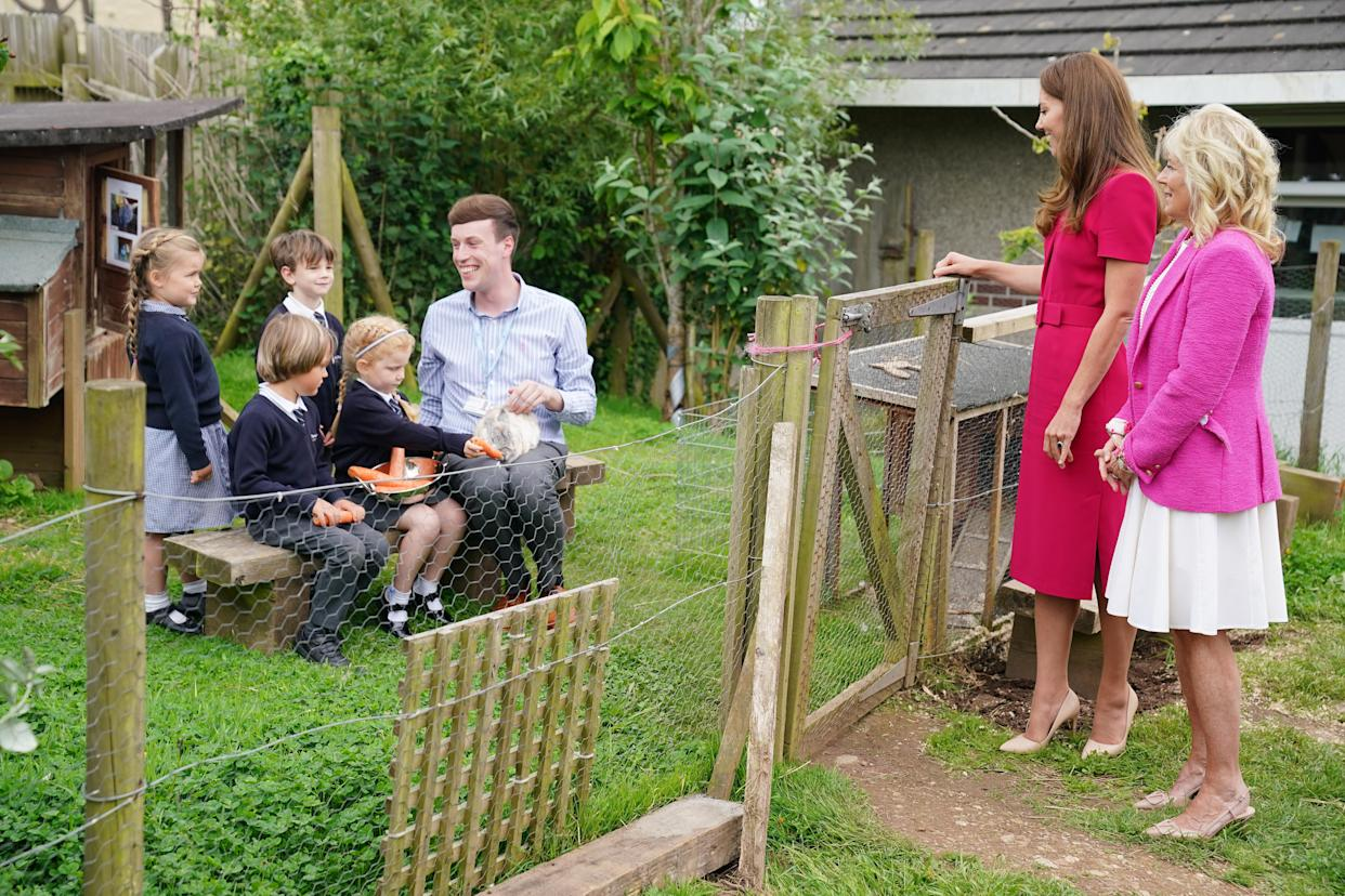 HAYLE, UNITED KINGDOM - JUNE 11: Catherine, Duchess of Cambridge and U.S. First Lady Dr Jill Biden (R) speak with the schools Reception Class and meet the school rabbit Storm, during a visit to Connor Downs Academy, during the G7 summit in Cornwall on June 11, 2021 in Hayle, west Cornwall, England. (Photo by Aaron Chown/WPA Pool/Getty Images)