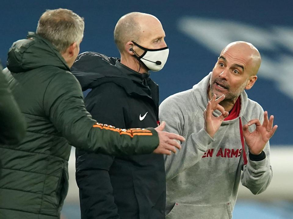 <p>Pep Guardiola speaks to Ole Gunnar Solskjaer on the touchline</p> (POOL/AFP via Getty Images)