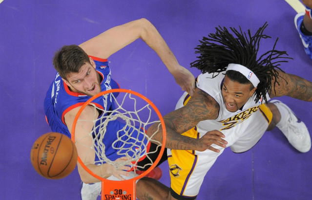 Philadelphia 76ers center Spencer Hawes, left, and Los Angeles Lakers center Jordan Hill battle for a rebound during the first half of an NBA basketball game, Sunday, Dec. 29, 2013, in Los Angeles. (AP Photo/Mark J. Terrill)