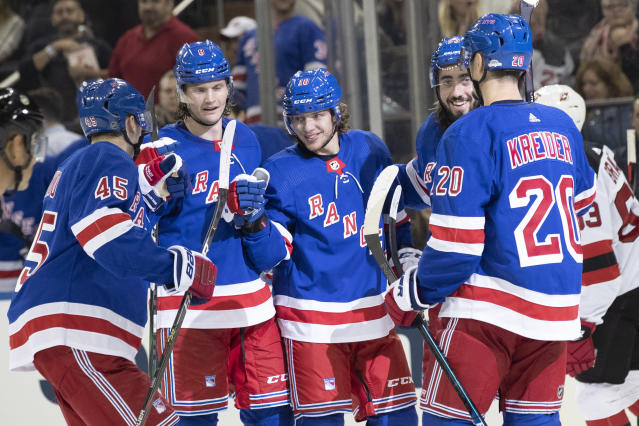 New York Rangers left wing Artemi Panarin, center, celebrates his goal during the second period of the team's preseason NHL hockey game against the New Jersey Devils, Wednesday, Sept. 18, 2019, at Madison Square Garden in New York. (AP Photo/Mary Altaffer)