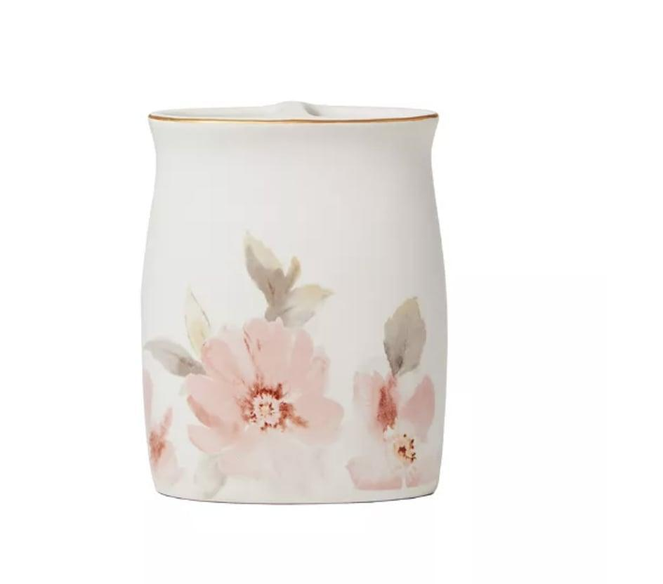<p>The delicate, blush pink flower design on the <span>Saturday Knight Misty Floral Toothbrush Holder</span> ($34) from Macy's is elegant yet understated. Pair it with a matching soap dispenser for a pulled-together look. </p>