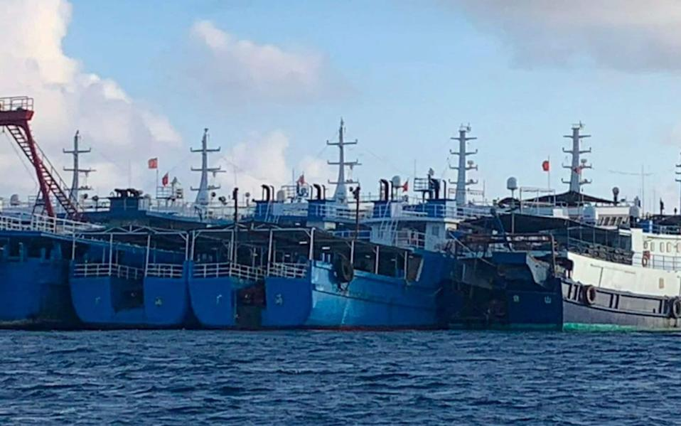 China says vessels gathered at the Whitsun reef are sheltering from rough seas - National Task Force - West Philippine Sea/AP