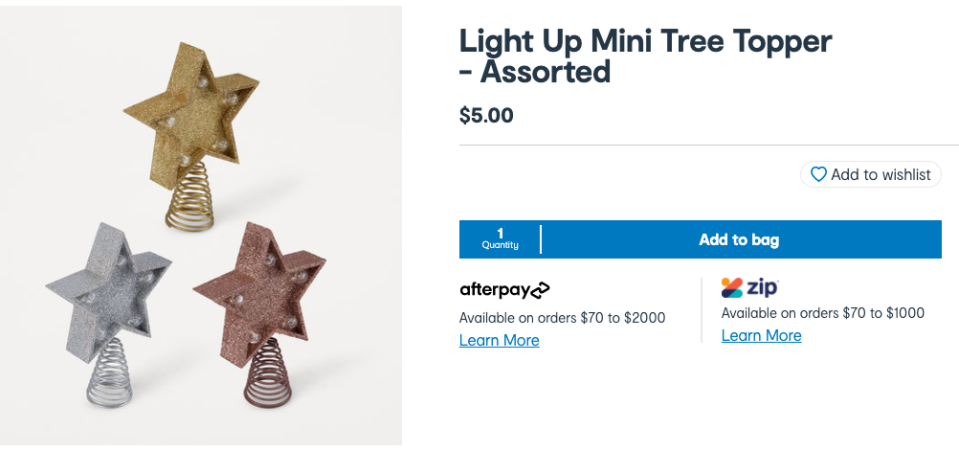 A light up mini tree topper ($5) was the final touch. Photo: Kmart.