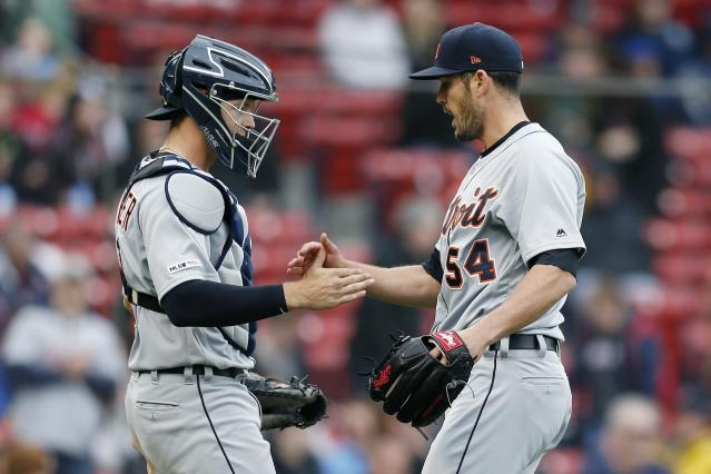 Detroit Tigers' Drew VerHagen (54) and Grayson Greiner celebrate after defeating the Boston Red Sox during the first game of a baseball doubleheader in Boston, Tuesday, April 23, 2019. (AP Photo/Michael Dwyer)