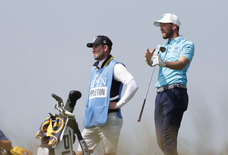 England's Nicholas Poppleton reacts after playing from the 8th tee during a practice round for the British Open Golf Championship at Royal St George's golf course Sandwich, England, Tuesday, July 13, 2021. The Open starts Thursday, July, 15. (AP Photo/Peter Morrison)