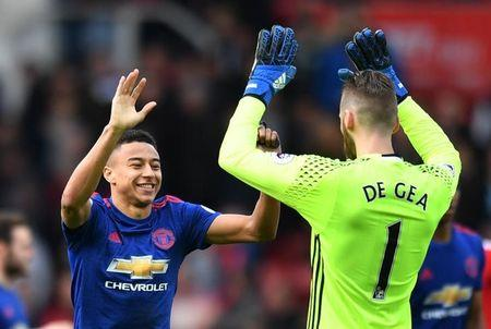 Britain Soccer Football - Middlesbrough v Manchester United - Premier League - The Riverside Stadium - 19/3/17 Manchester United's Jesse Lingard celebrates after the game with David De Gea  Reuters / Anthony Devlin Livepic