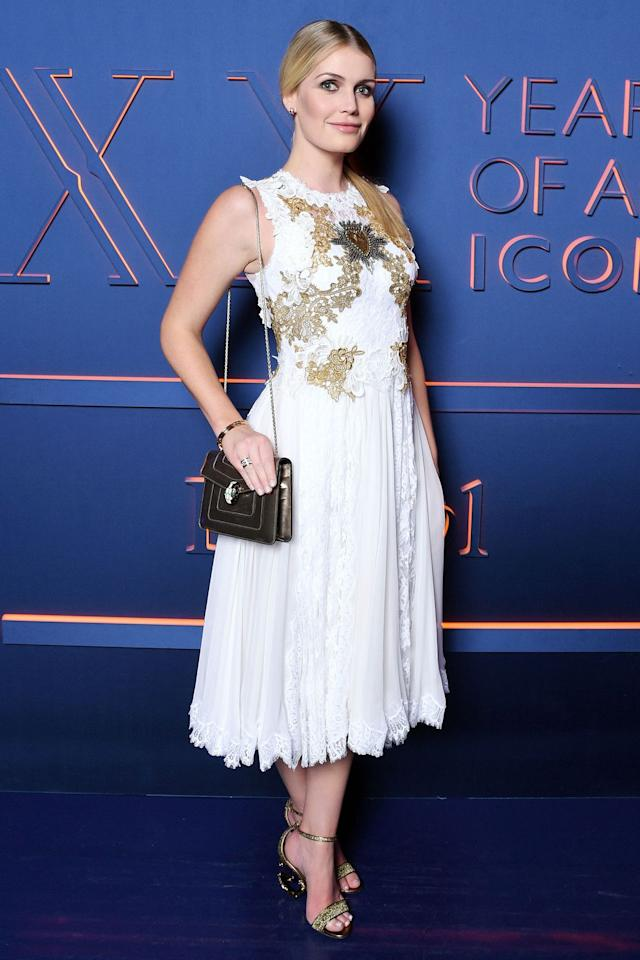 <p><strong>19 February </strong>Lady Kitty Spencer paired her white lace dress with gold statement sandals, a Bulgari handbag and Bulgari jewellery.</p>