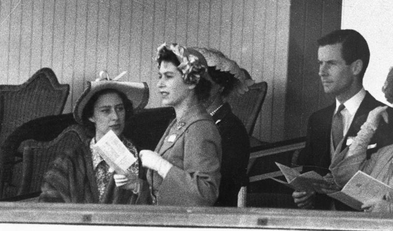 400806 32: (FILE PHOTO) Princess Margaret (L), Princess Elizabeth and Group Captain Peter Townsend gather June 13, 1951 in the Royal Box at Ascot. In 1955 Princess Margaret was refused permission to marry Townsend, a divorced Royal Air Force captain. Buckingham Palace announced that Princess Margaret died peacefully in her sleep at 1:30AM EST at the King Edward VII Hospital February 9, 2002 in London. (Photo by Getty Images)