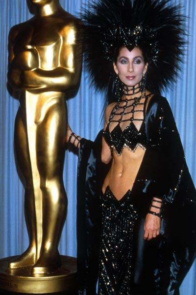 This feathered dress might have been the right pick for a fancy dress maybe! But definitely did not make a mark at the Oscars. Worst - dressed-(1988)