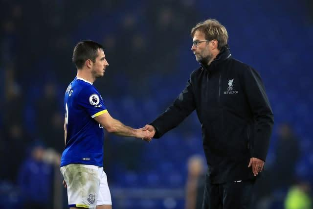 Liverpool manager Jurgen Klopp (right) shakes hands with Everton's Leighton Baines (Mike Egerton/PA)