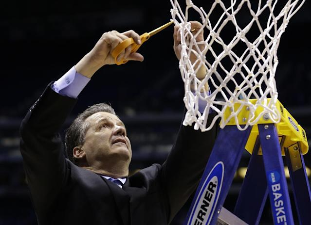 Kentucky head coach John Calipari cuts the net after an NCAA Midwest Regional final college basketball tournament game against Michigan Sunday, March 30, 2014, in Indianapolis. Kentucky won 75-72 to advance to the Final Four. (AP Photo/Michael Conroy)