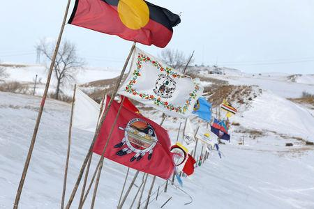 Tribal flags catch the wind in the opposition camp against the Dakota Access oil pipeline near Cannon Ball, North Dakota, U.S., February 8, 2017. REUTERS/Terray Sylvester