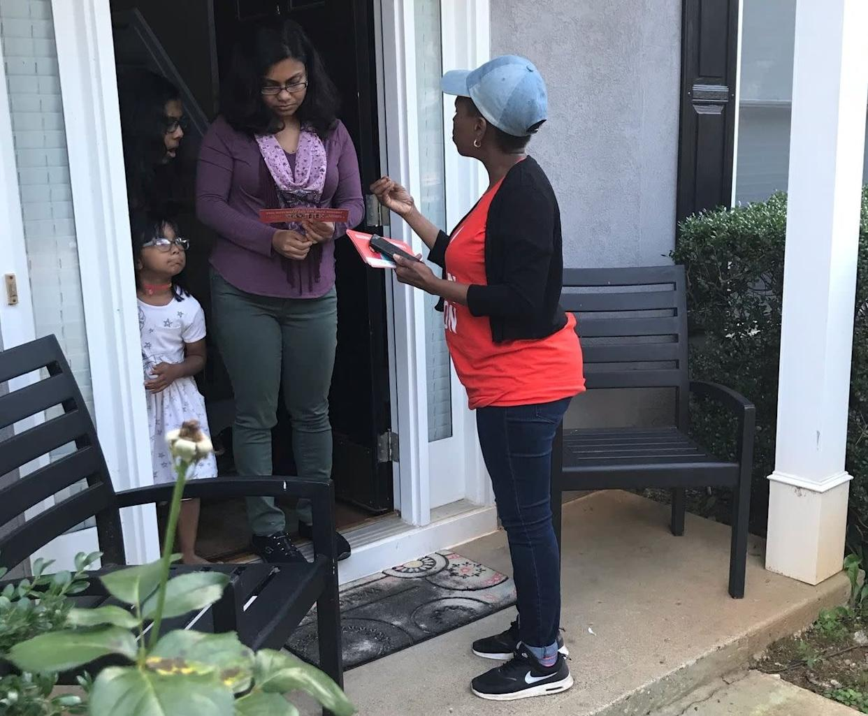 Nilaja Fabien, a 46-year-old nanny originally from Trinidad, talks to a woman in Gwinnett County, Georgia, about Stacey Abrams' campaign for governor. (Photo: Laura Bassett/HuffPost)