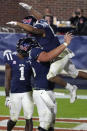 Mississippi running back Jerrion Ealy (9) is lifted in the end zone by a teammate as he celebrates his 8-yard touchdown run during the second half of an NCAA college football game against Mississippi State, Saturday, Nov. 28, 2020, in Oxford, Miss. (AP Photo/Rogelio V. Solis)
