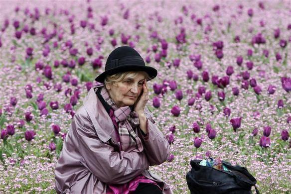 A woman rests during a protest marking the 20th anniversary of the start of the Bosnian war in Belgrade April 6, 2012. The anniversary finds the Balkan country still deeply divided, power shared between Serbs, Croats and Muslims in a single state ruled by ethnic quotas and united by the weakest of central governments.