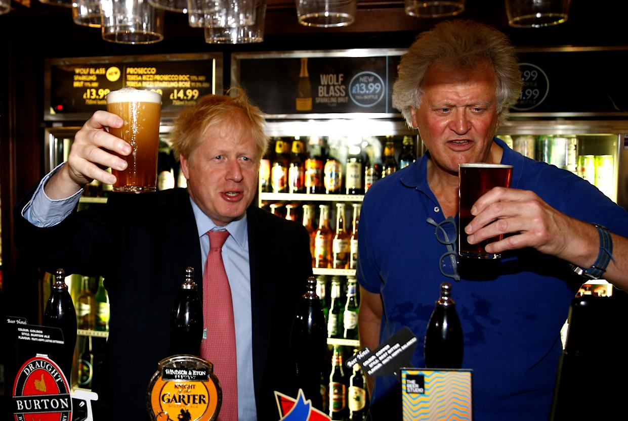 Boris Johnson, a leadership candidate for Britain's Conservative Party, meets JD Wetherspoon chairman Tim Martin at Wetherspoons Metropolitan Bar in London, Britain, July 10, 2019. REUTERS/Henry Nicholls/pool