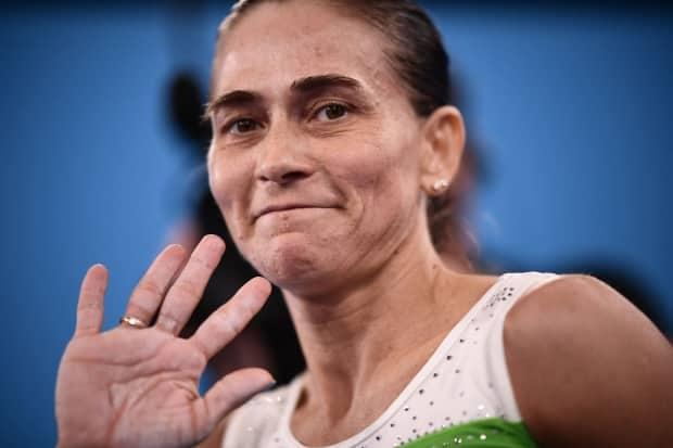 Uzbekistan's Oksana Chusovitina is retiring, at the age of 46, after competing in her record-extending eighth Olympic Games in Tokyo on Sunday.   (Loic Venance/Getty Images - image credit)
