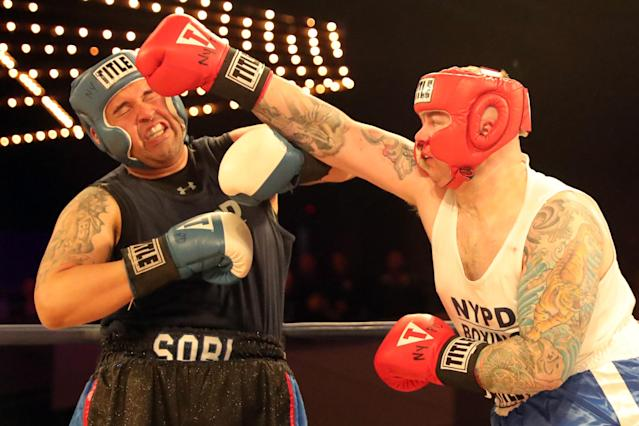<p>Robert Marzano (red) hits Jafet Sori (blue) with a solid right in the TD1 ATU Grudge Match at the NYPD Boxing Championships at the Hulu Theater at Madison Square Garden on March 15, 2018. (Gordon Donovan/Yahoo News) </p>