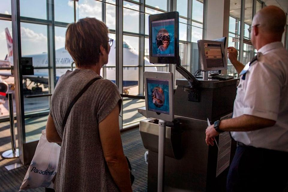 A woman boarding a SAS flight to Copenhagen goes through facial recognition verification system VeriScan at Dulles International Airport in Dulles, Virginia (AFP via Getty Images)