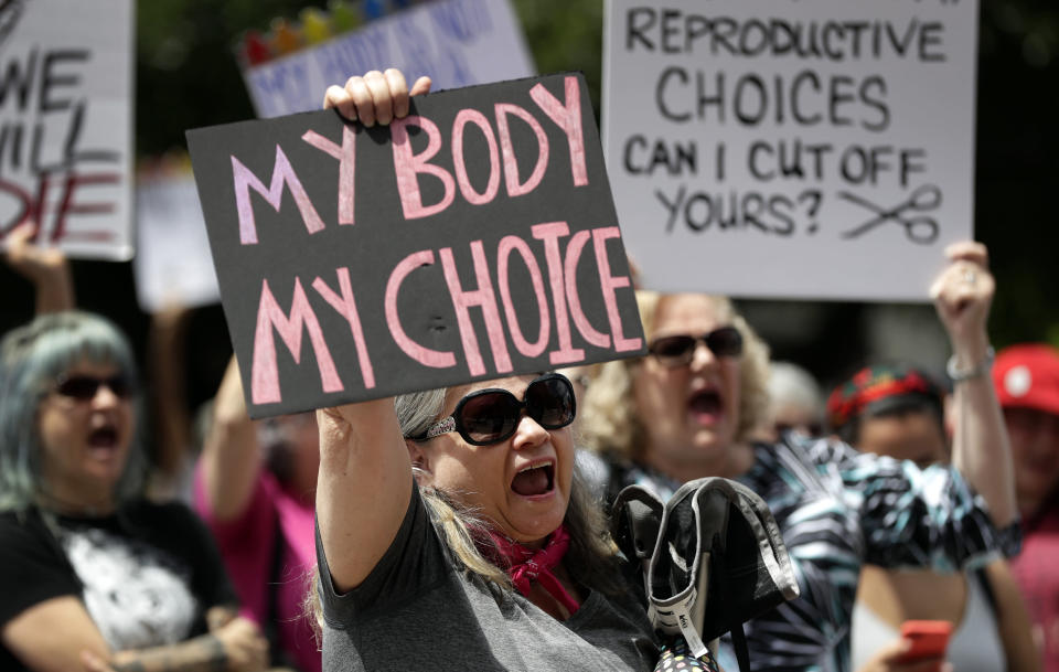 FILE - A group gathers to protest abortion restrictions at the State Capitol in Austin, Texas, Tuesday, May 21, 2019. Abortion rights advocates say the pandemic has demonstrated the value of medical care provided virtually, including the privacy and convenience of abortion taking place in a woman's home, instead of a clinic.(AP Photo/Eric Gay, File)